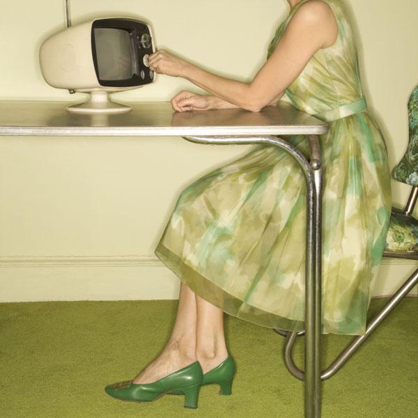 Retro woman turning on tv
