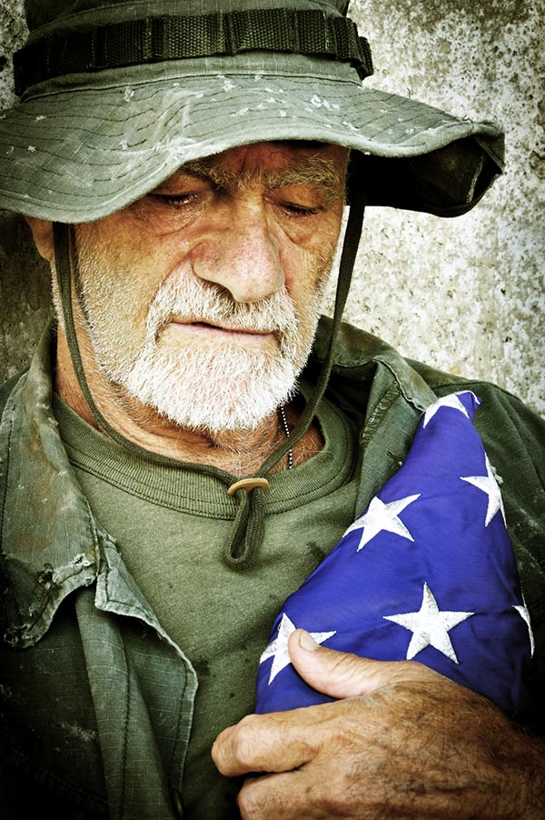 Vietnam veteran holding flag