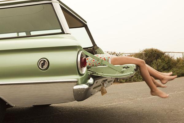 Two girls kicking back on tailgate