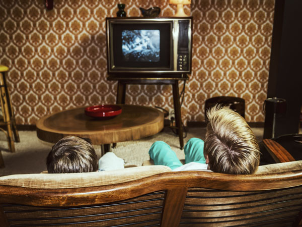 Two retro boys watching tv