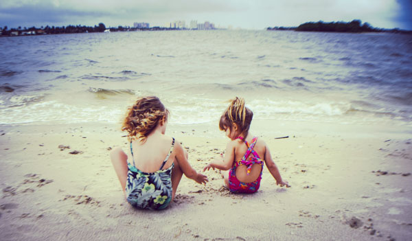 Two girls playing on sea shore