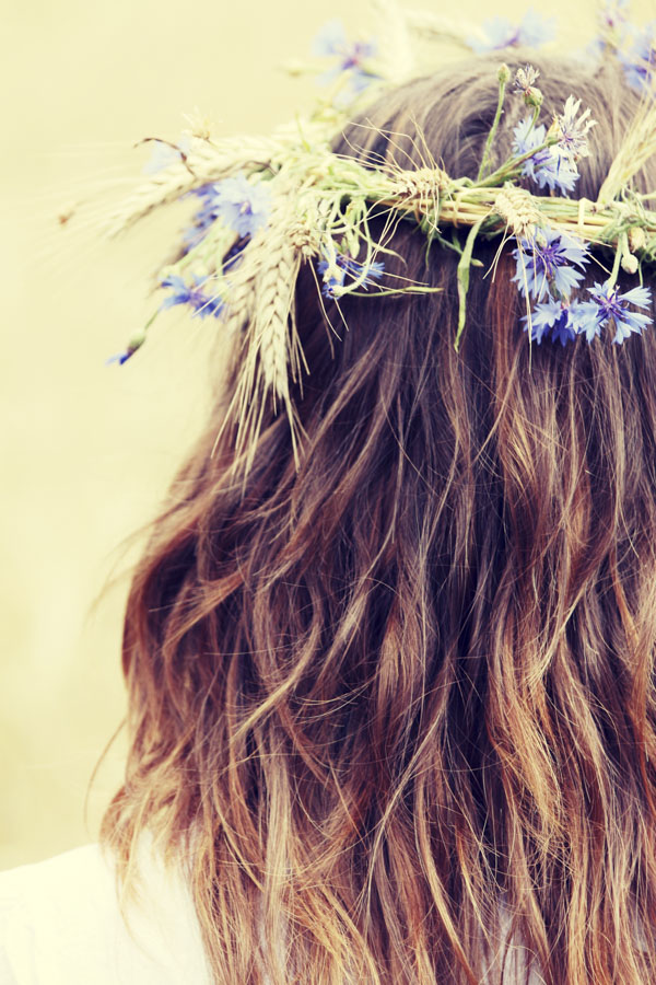 Woman with flower garland in hair
