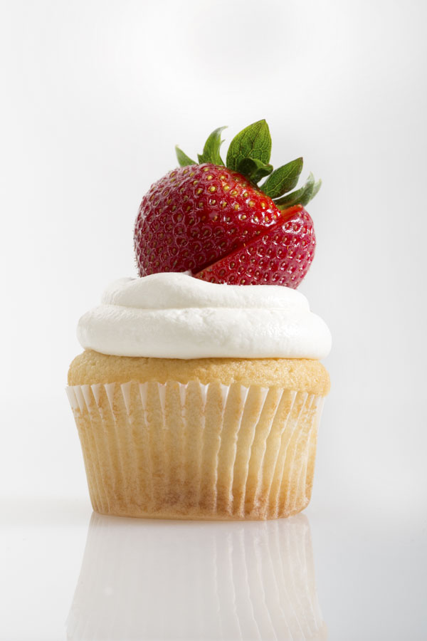 Vanilla cupcake with strawberry on top
