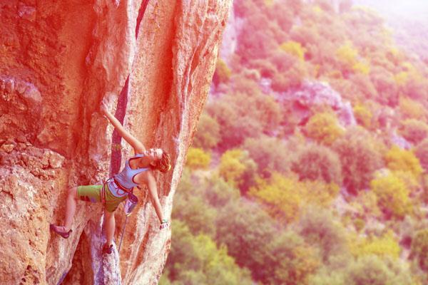 Woman climber on mountain face