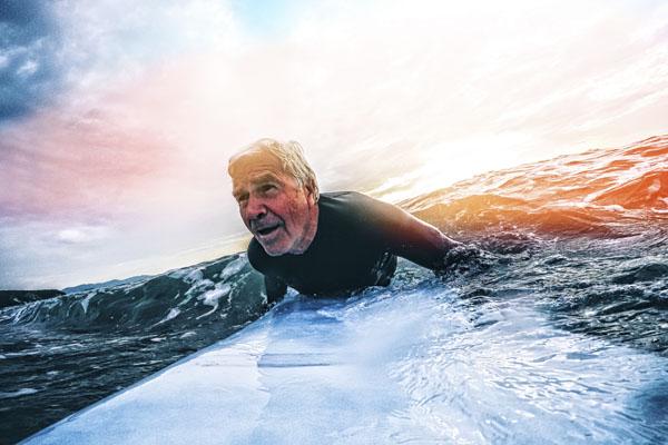 Senior man on surfboard