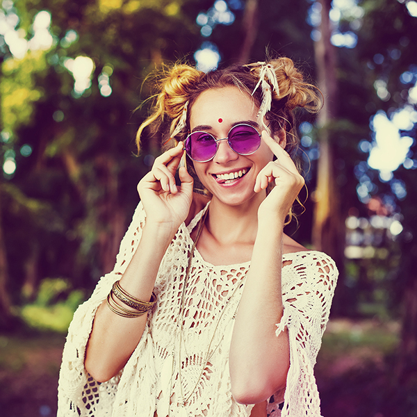Young woman wearing rose colored glasses