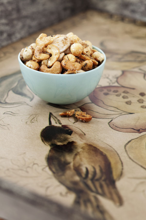 bird tablecloth and bowl of nuts