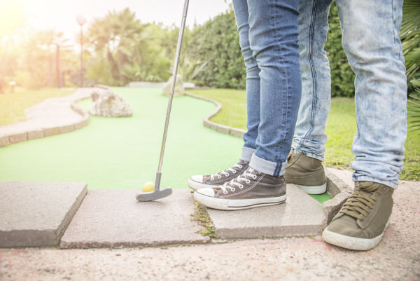 Couple miniature golfing