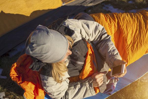 Woman in sleeping bag camping