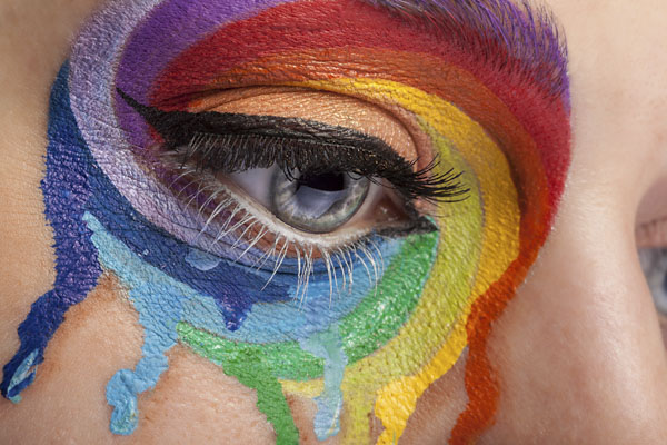 Woman with colorful tears