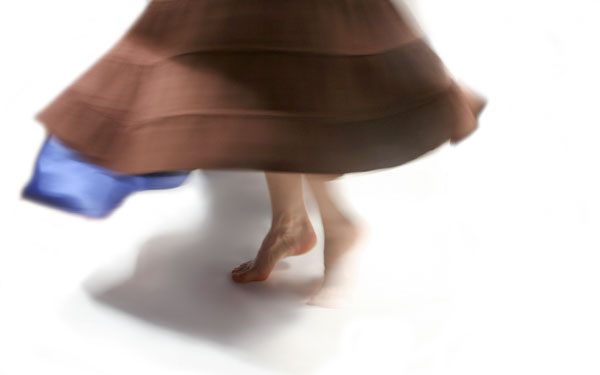 Barefoot twirling woman