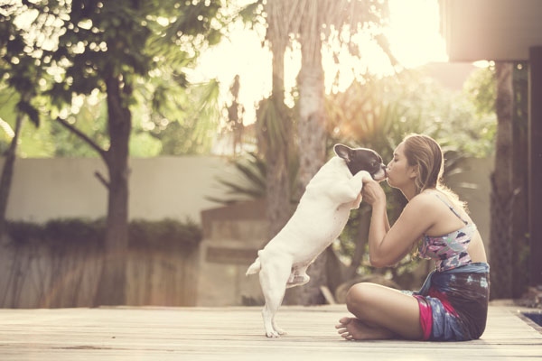 Girl kissing dog