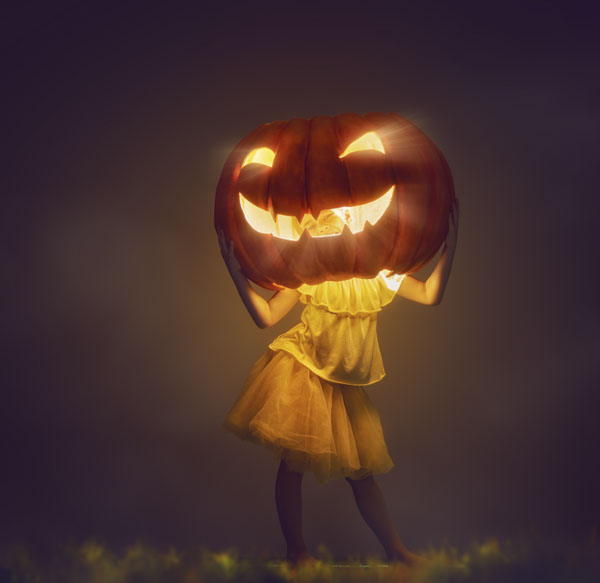 Girl with pumpkin head shining bright