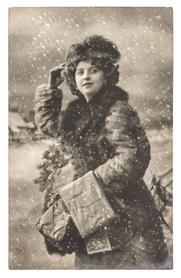 Vintage woman with Christmas tree and gifts
