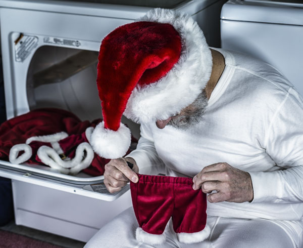Santa Claus in disbelief at his pants out of the dryer