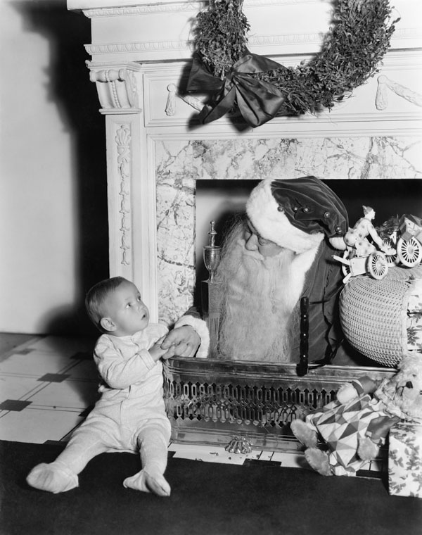 Santa Claus coming down chimney