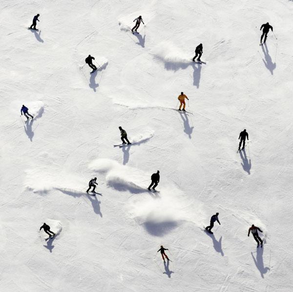 Skiiers blazing trail down hill
