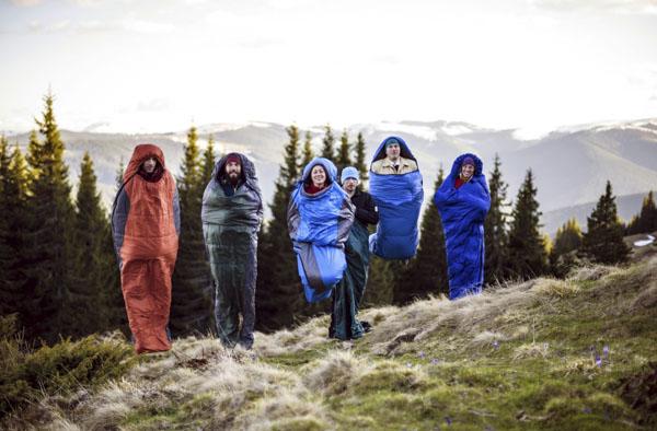 Team jumping in sleeping bags
