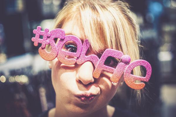 Girl with cute selfie glasses
