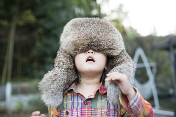 Winter hat pulled down over eyes