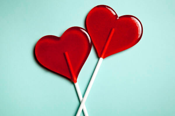 Red heart shaped lollipops side by side