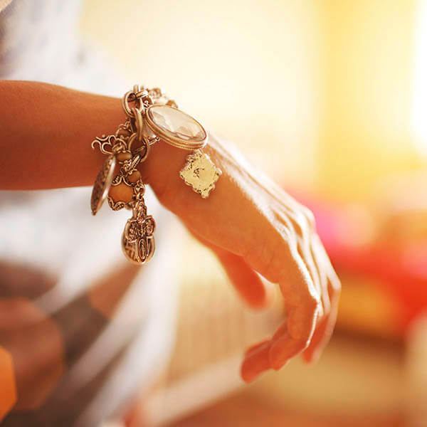 Woman's arm with charm bracelet