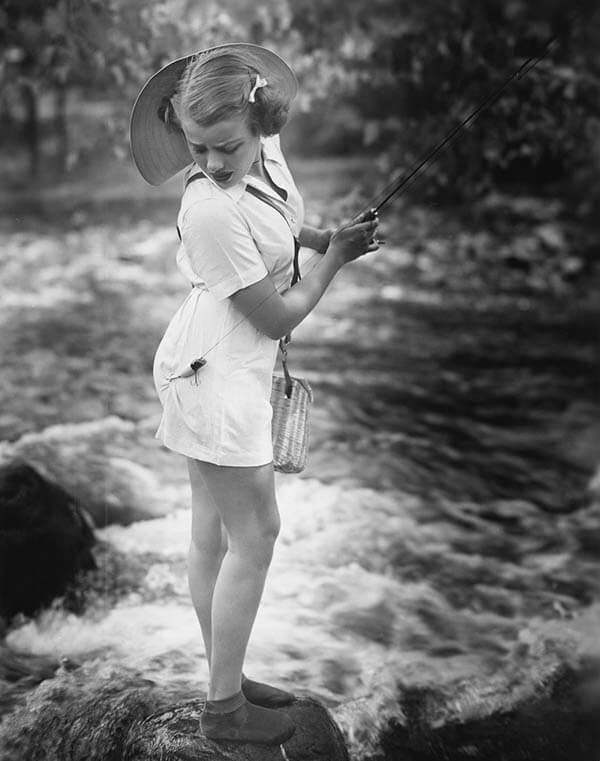 Woman fishing and hook in shorts