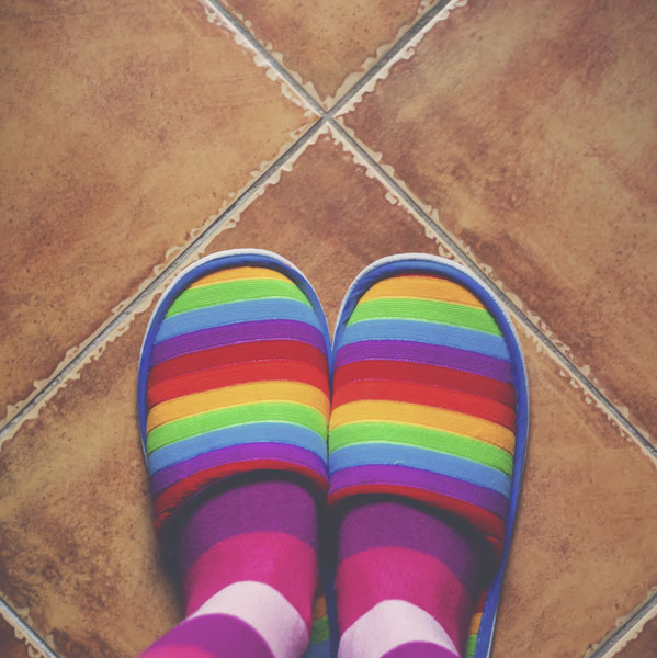 Rainbow slippers and striped socks