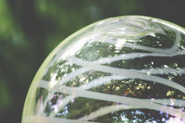 Clear gazing ball with white lines