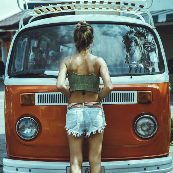 Woman looking in van windshield