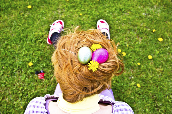 Woman with colorful Easter eggs in her hair