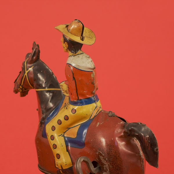 Antique tin toy cowboy on wind up horse