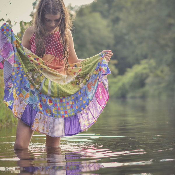 Little girl wading in river