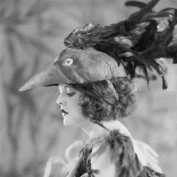 Vintage woman in paper machine rooster hat
