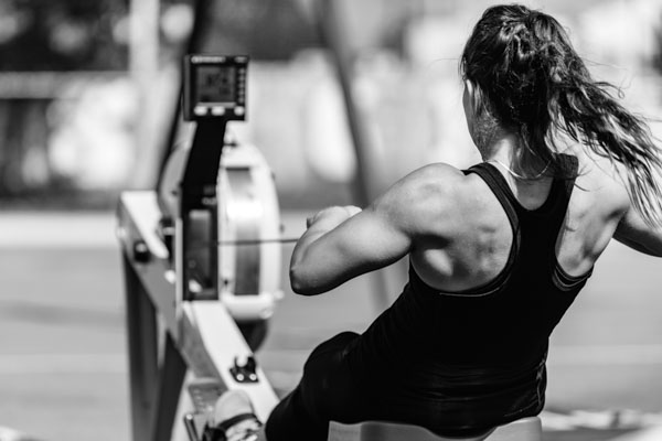 Female athlete on rowing machine