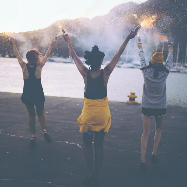 Three women holding fireworks