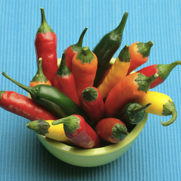 Yellow, green, orange and red peppers in a bowl