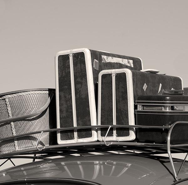 Picnic basket and luggage on car rack