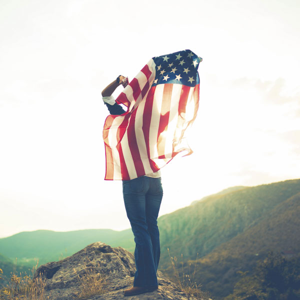 Woman flying United States flag