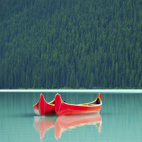 Two canoes on peaceful mountain lake